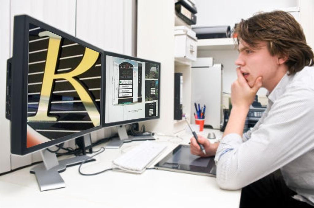 Guy sitting at desk looking at computer screen