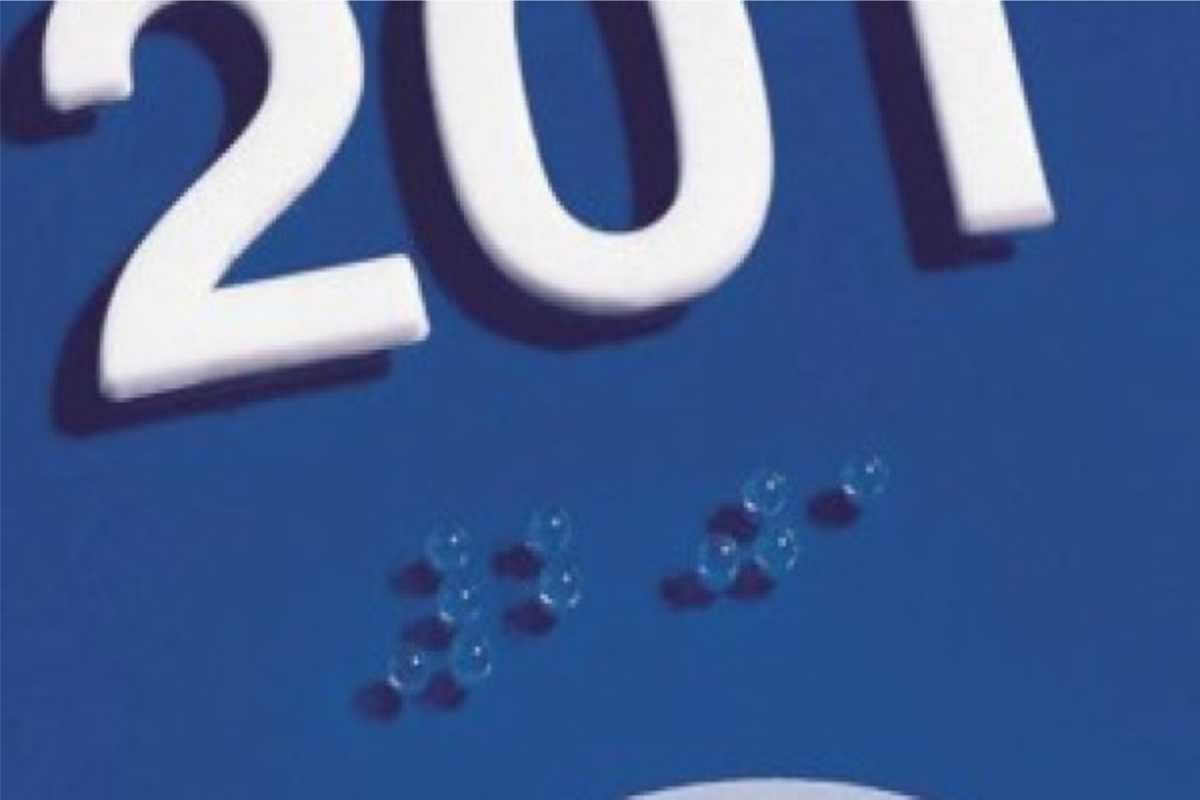 closeup of sign with braille numbers