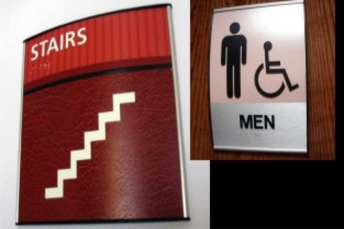 stairs and restroom signs
