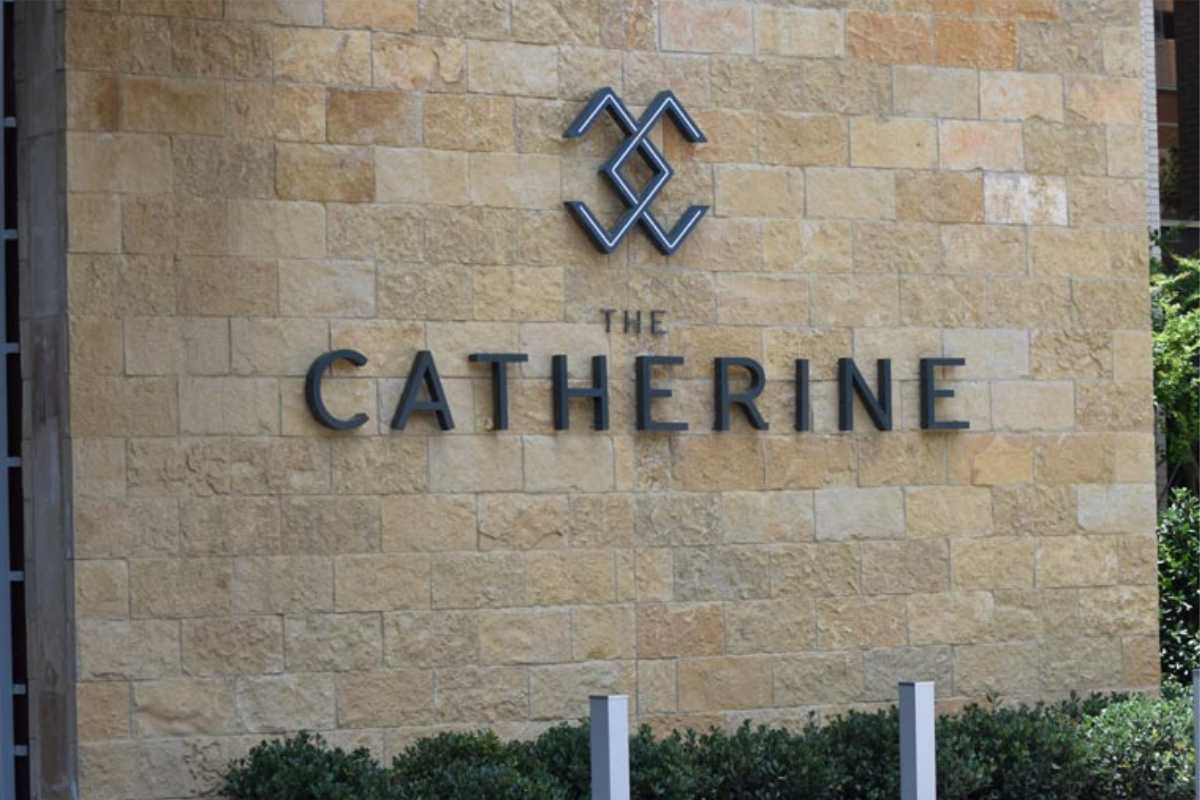 the Catherine apartment building exterior with logo/ sign/ lettering