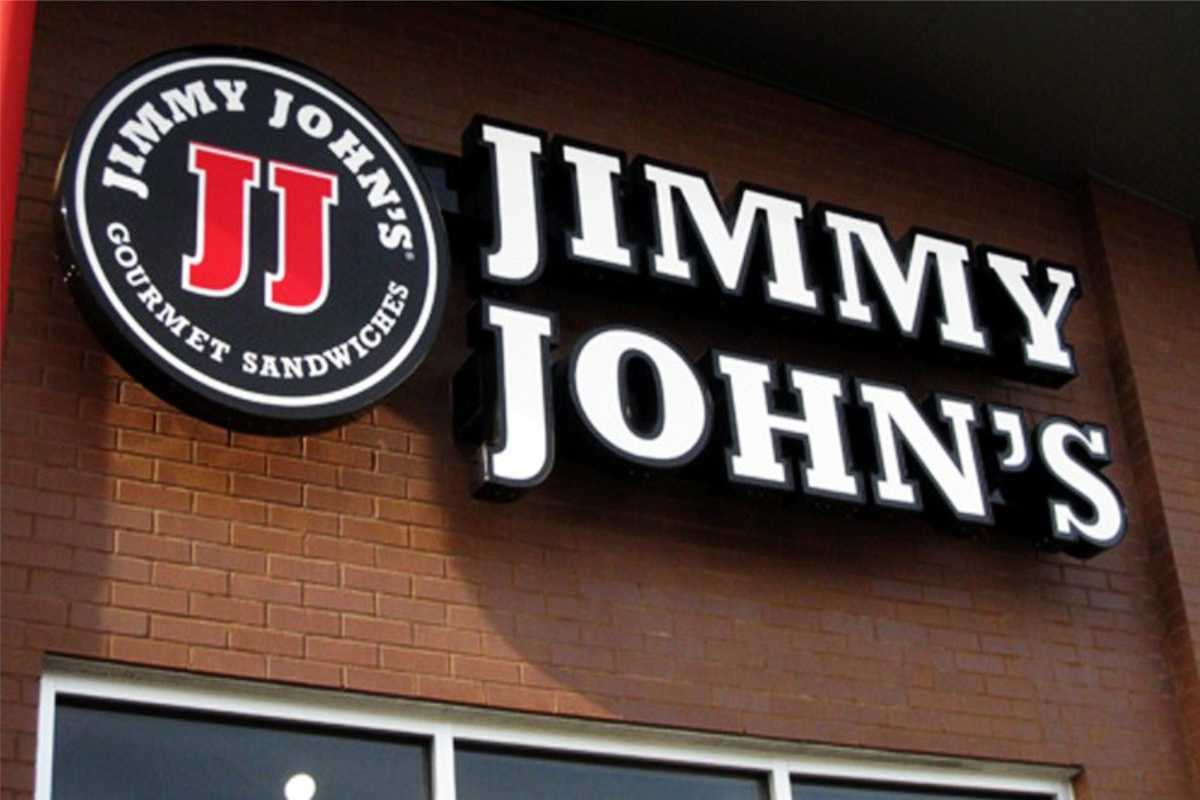 Jimmy John's channel letter signs and graphic against a brick building