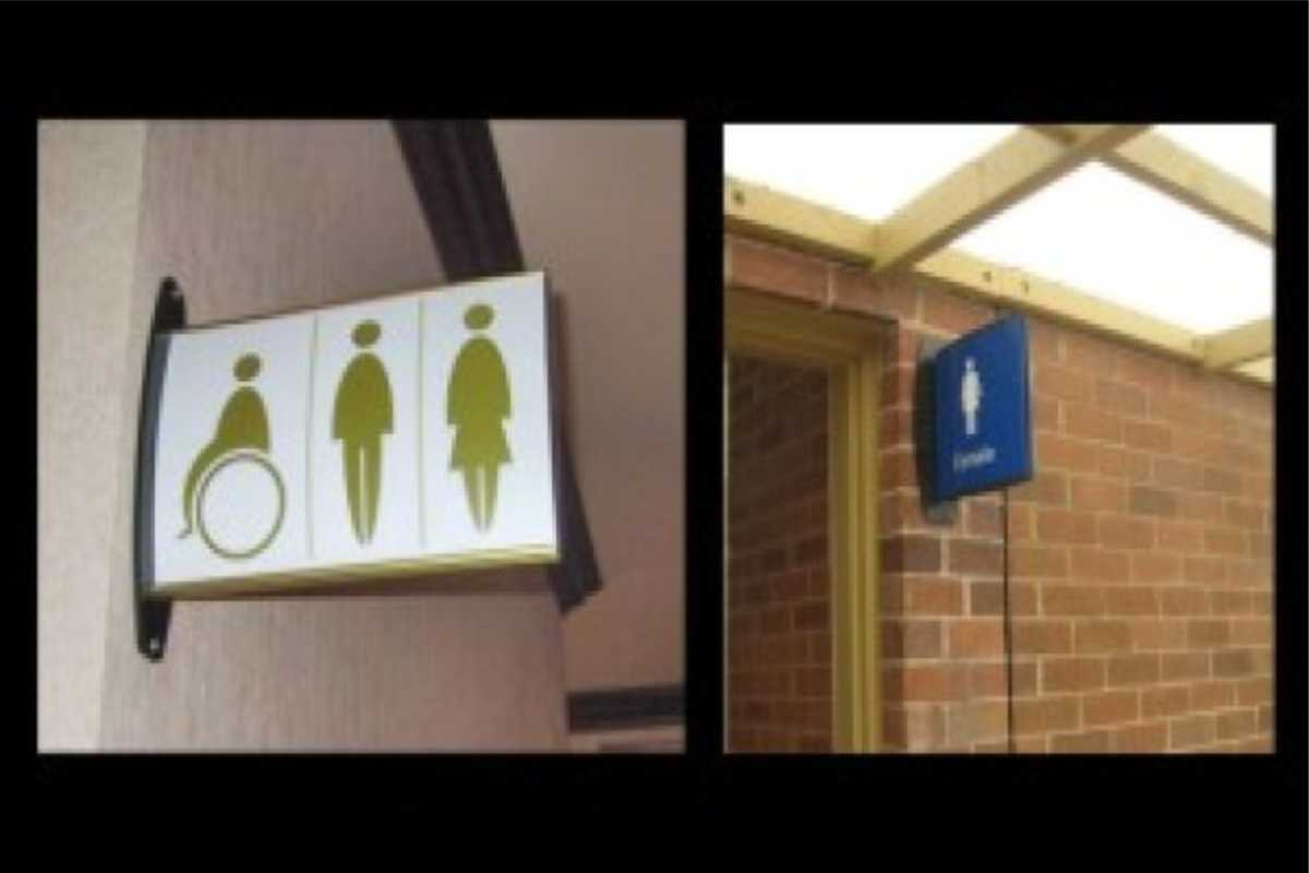 various signs for restrooms