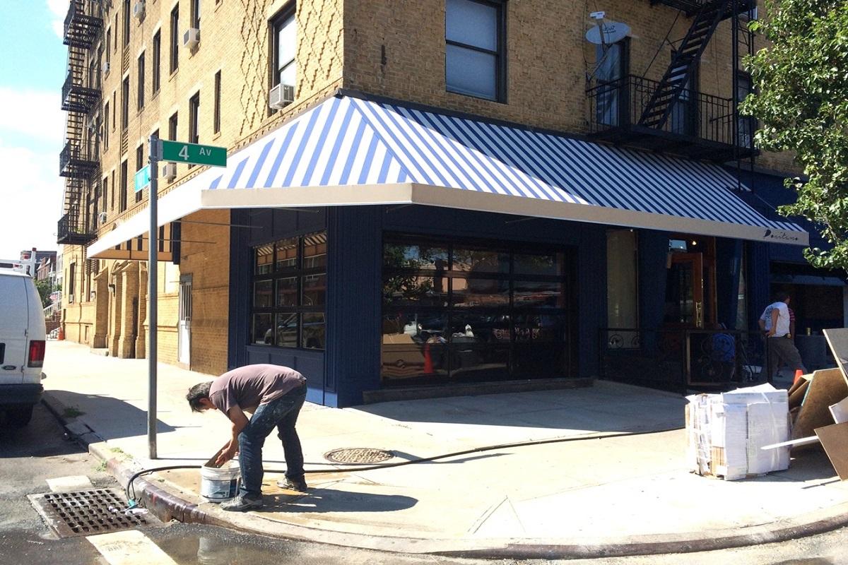 stationary awning at street corner location