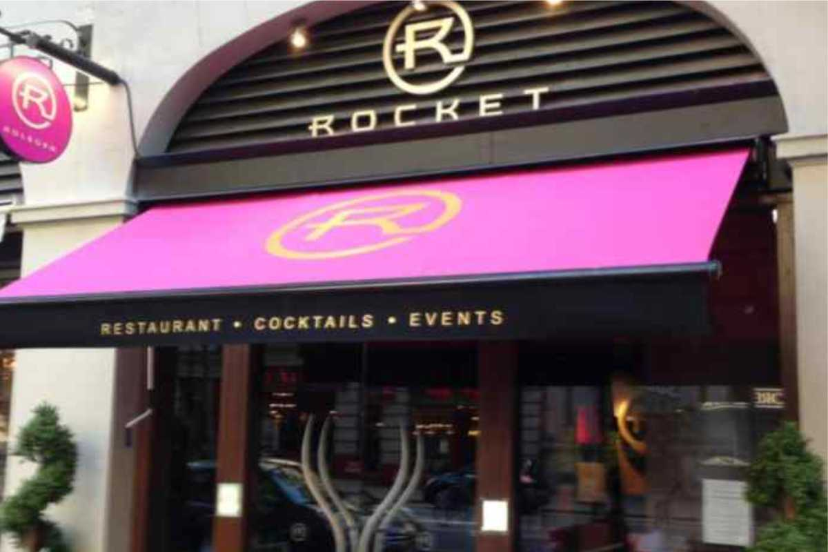 commercial retractable awning outside rocket restaurant
