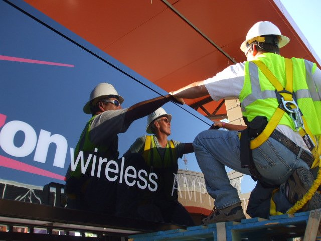 Workers installing a sign