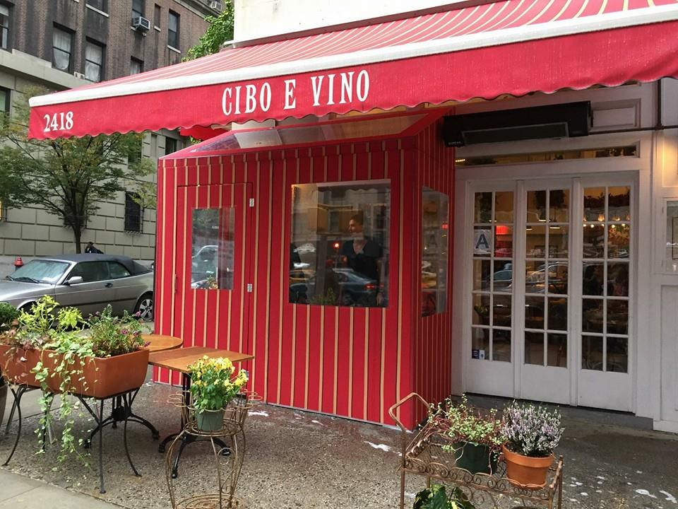 A temporary vestibule and awning outside Cibo E Vino